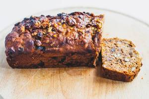 Vegan date walnut bread on wooden board