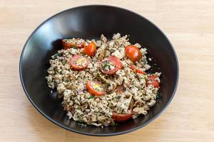 Vegan scrambled eggs with tomatoes and herbs