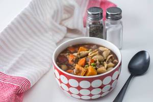 Vegetable Soup With Pasta and Lentil On a white Background