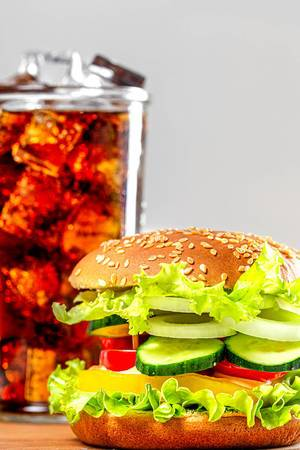 Vegetable vegetarian Burger with a cold glass of Pepsi (Flip 2019)