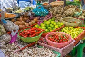 Vegetable Vendor at a Local Food Market in Saigon