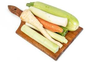 Vegetables on the cutting board isolated above white background (Flip 2019)