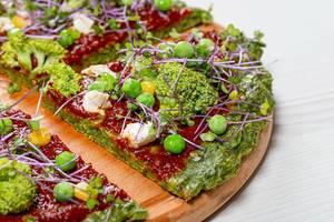 Vegetarian pizza with micro-green cabbage, tomato sauce, broccoli, corn, peas and feta cheese (Flip 2019)