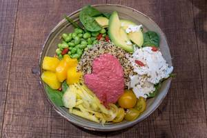 "Vegetarian ""Spring Time Bowl"" with quinoa, yoghurt mint dressing, avocado, yellow beetroot, edamame, goji berry, baby spinach & beetroot mayo"