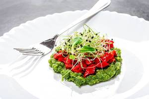 Vegetarian salad layers with fresh vegetables and onion seed sprouts on a white plate with fork (Flip 2019)