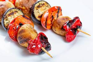 Vegetarian shashlik on a wooden skewer of vegetables