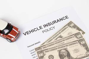 Vehicle Insurance Policy with red toy car
