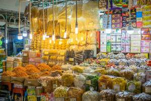 Vendor at Ben Thanh Market in Saigon offering a variety of Snacks