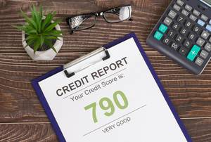Very good credit score report of 790 on wooden desk