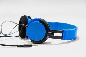 Vibrant blue headphones on white background (Flip 2019)