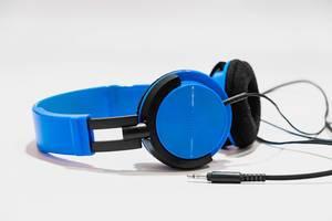 Vibrant blue headphones on white background.jpg