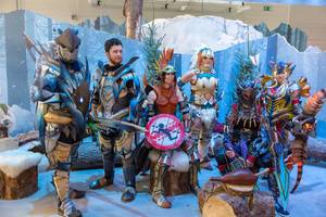 Video gamers in cosplay costumes in the ice landscape of Monster Hunter World: Iceborne