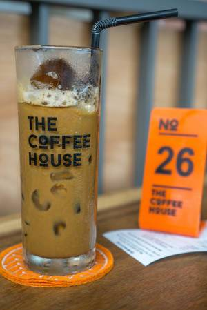 Vietnamese Iced Coffee with Order and Receipt in the Background