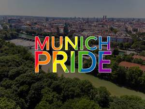 "View over the German city Munich with the rainbow-coloured title """"Munich Pride"", to celebrate LGBTQ-rights in Germany"