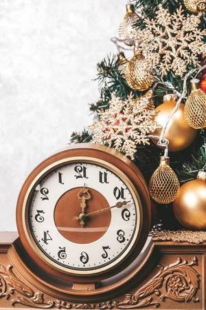 Vintage clock on background Christmas tree (Flip 2019)