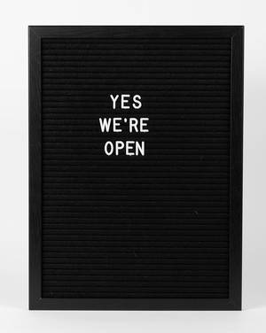 "Vintage ""we are open"" sign for a shop"