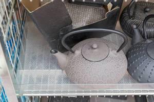 Vintage teapots made of cast iron at Naschmarkt in Vienna
