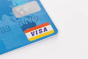 Visa credit card on white background