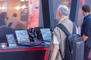 Visitor checking out an Asus FX505 gaming laptop