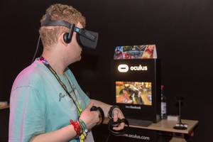 Visitor playing MARVEL Powers United VR Oculus Rift Headset and Touch Controller