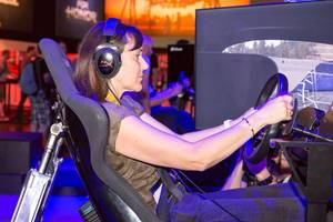 Visitor playing Need For Speed Payback - Gamescom 2017, Cologne