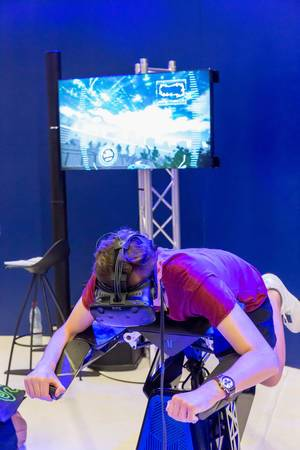 Visitor trying out VR flight simulation at Airbus booth