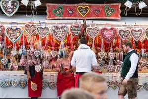 Visitors buying gingerbread hearts - Oktoberfest 2017