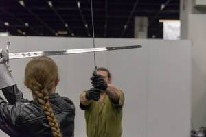 Visitors fighting with LARP swords