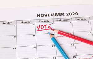 Vote reminder in calendar with red and blue pen.jpg