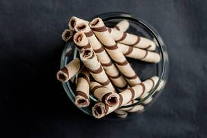 Waffle rolls with chocolate, top view