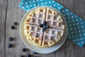 Waffles with blueberries top view