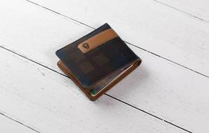 Wallet on white wooden table