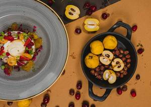 Warm Composition Of Quince, Hazelnuts And Berries