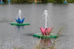 Water lily installations with splashing water at the lake of Tomorrowland