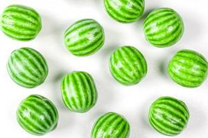 Watermelon chewing candy on a white background, top view (Flip 2020)