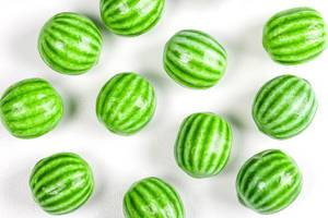 Watermelon chewing candy on a white background, top view