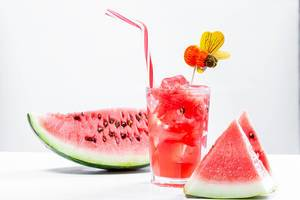 Watermelon drink in glass with slices of watermelon (Flip 2019)