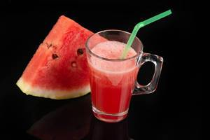 Watermelon Juice above black reflective background