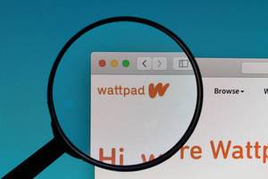 Wattpad logo under magnifying glass