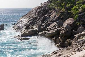 Waves at rocky coast of Seychelles island Mahé, near Anse des Anglais at Constance Ephelia Resort
