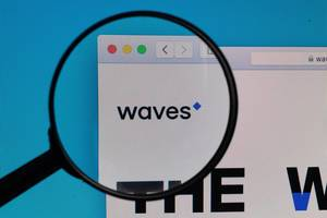 Waves logo under magnifying glass