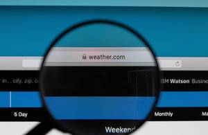 Weather.com website under magnifying glass