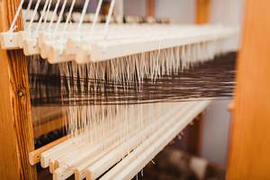 Weaving Loom Background With Close Up Yarn