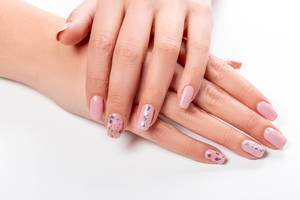 Well-groomed female hands with manicure on a white background (Flip 2020)