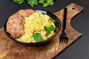 Wheat porridge with fresh parsley and cutlets on a dark background (Flip 2020)
