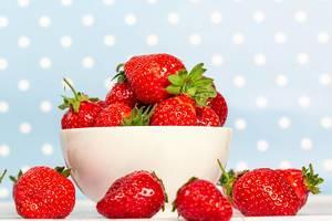 White bowl full of strawberries