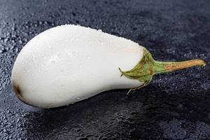 White eggplant with water drops closeup