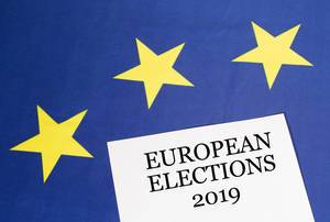 White paper with European elections 2019 text on European Union flag