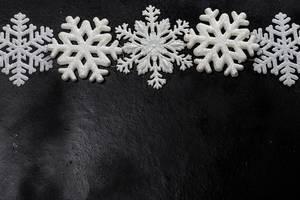 White snowflakes on a black background. Free space (Flip 2019)