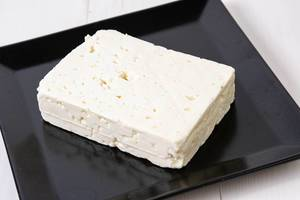 White square Cheese on the black plate (Flip 2019)